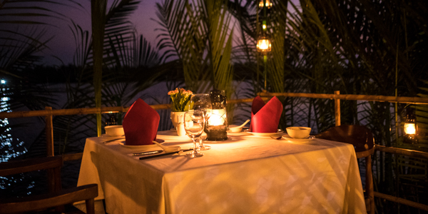 Romantic table near Co Co river at eco resort hoi an